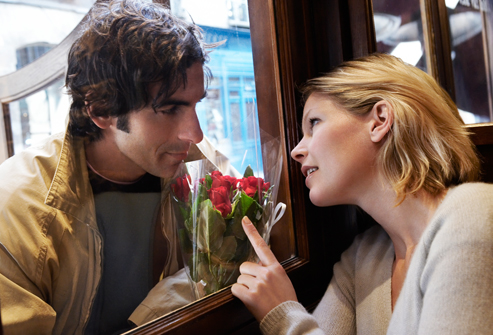 getty_rf_photo_of_man_giving_woman_flowers